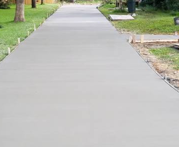 construction workers doing concrete driveway